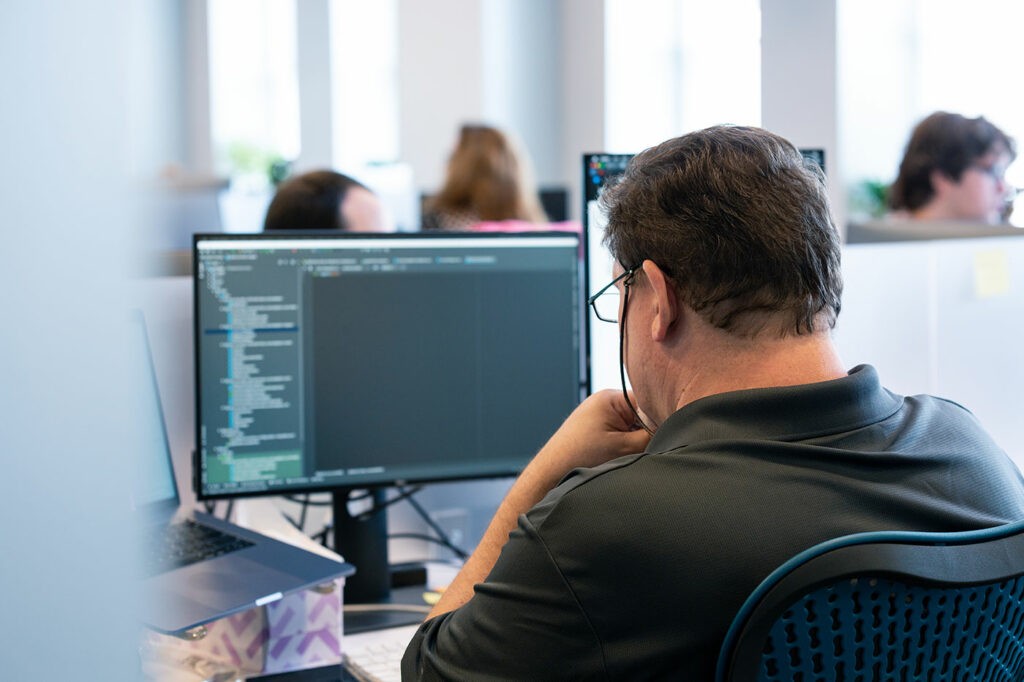 Core10 employee completing software implementation and testing